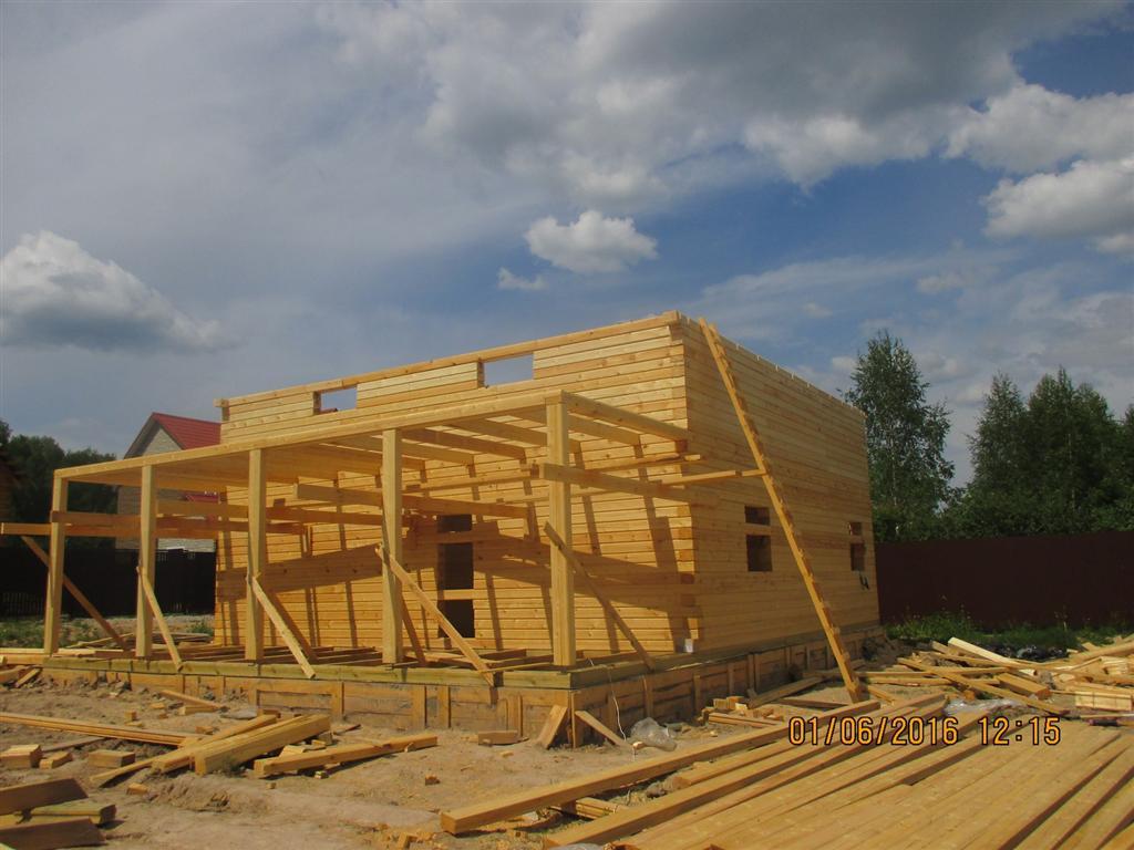 Дом из проф бруса 9х9 метров, с открытой террасой